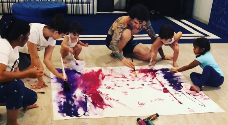 Sunny Leone works with daughter Nisha as a team to complete a painting